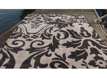 Tapis peau de vache patchwork noir et blanc for Tapis raye noir beige